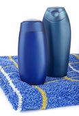 Dwie butelki i ręcznik — Zdjęcie stockowe