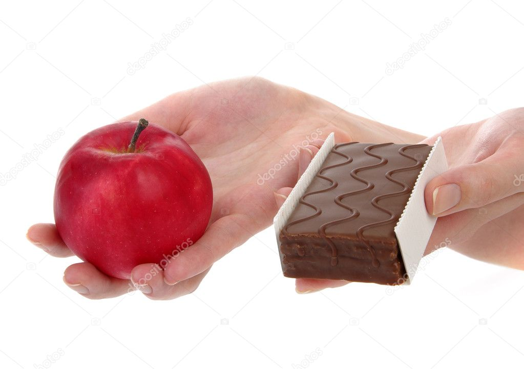 Hands holding up an apple and cookie — Stock Photo #2483075