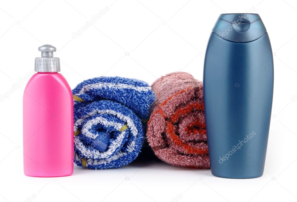 cosmetic bottles with towel — Stock Photo #2484446