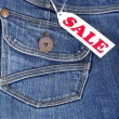 Stock Photo: Jeans pocket with label sale