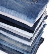 Jeans stack isolated on white — Stock Photo