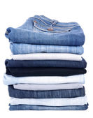 Jeans stack isolated on white — Zdjęcie stockowe