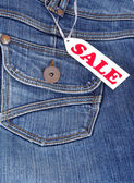 Jeans pocket with label sale — Stockfoto