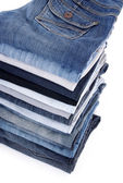 Pile de jeans isolé sur blanc — Photo