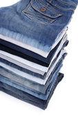 Pila di jeans isolato su bianco — Foto Stock
