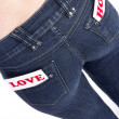 Jeans pocket with labels — Stock Photo