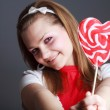 Beautiful girl with big lollipop — Stock Photo