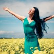 Happy beautiful woman in the field — Stok fotoğraf