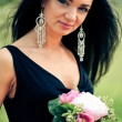 Beautiful young woman with bouquet — Stok fotoğraf