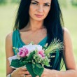 Foto de Stock  : Beautiful young womwith bouquet