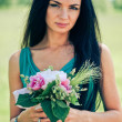 Stock Photo: Beautiful young womwith bouquet