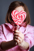 Beautiful girl with big lollipops — Stock Photo