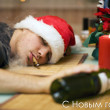 Stock Photo: Drunk man in santa's hat