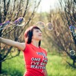Beautiful model blowing bubbles — Stock Photo #1684218