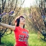 Beautiful model blowing bubbles — Stock Photo