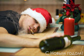 Drunk man in santa's hat — Photo