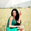 Girl with book under an umbrella - Lizenzfreies Foto