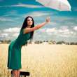 Girl with an umbrella in the field - Lizenzfreies Foto