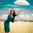 Girl with umbrellin field — Stok Fotoğraf #1809803