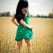 Woman running in yellow field — Stock Photo