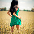 Stock Photo: Womrunning in yellow field