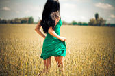 Woman running in yellow field — Stok fotoğraf
