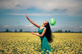Beautiful woman with balloon — Stock Photo