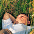 Stock Photo: Young adult man in spring grass