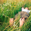 Young adult man in spring grass — Stock Photo