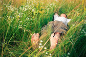 Young adult man in spring grass — Foto de Stock