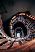 Very old spiral stairway case — 图库照片