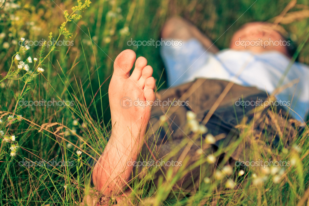 Young adult man in spring grass  Stock Photo #1811743