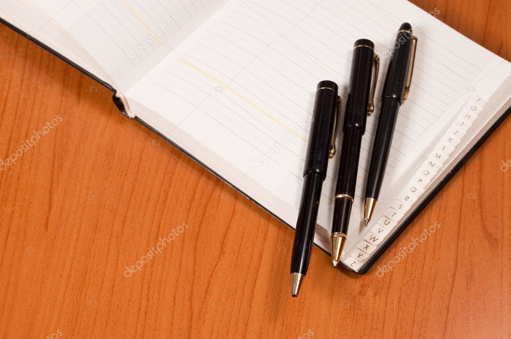 Opened address books with pens — Stock Photo #1726471