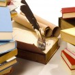 Books and quill and ink well — Stock Photo