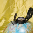 Globe and compass — Stock Photo