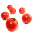 Scattered cherry tomato — Stock Photo