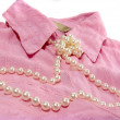 Pearls and pink shirt — Stock Photo