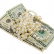 Pearls necklace and dollars — Stock Photo
