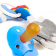 Soother, rattles and baby socks — Stock Photo