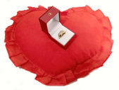 Gold ring on the red pillow — Stock Photo