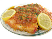 Fried hake with tomato sauce — Stock Photo