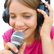Stock Photo: Young girl singing