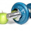 Dumbbell and green apple — Stock Photo