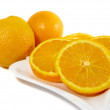 Orange slices and two orange — Stock Photo
