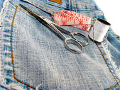 Jeans and tailor accessories — Stock Photo