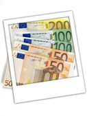 Euro bills through photo frame — Stock Photo