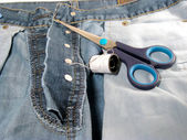 Jeans pants and equipment — Stock Photo