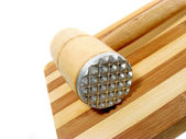 Wooden mallet and board — Stock Photo