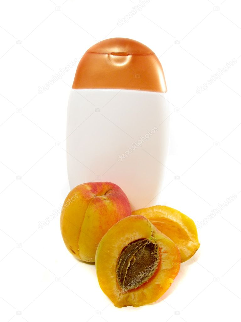Blank shampoo bottle and apricot isolated on white — Stock Photo #1905128