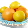 Lemon and red grapefruit in bowl - Stock Photo